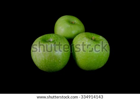 Green apple on a black background - stock photo