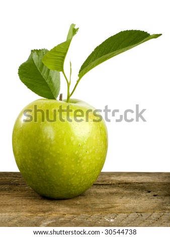 green apple on a wooden table - stock photo
