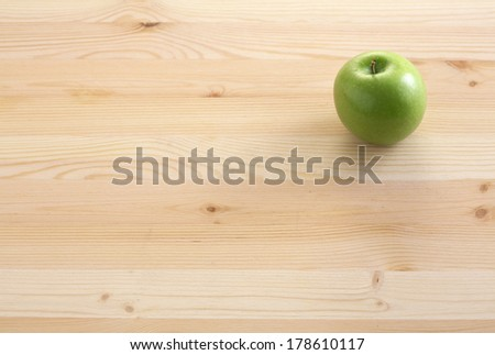 green apple on table wood - stock photo