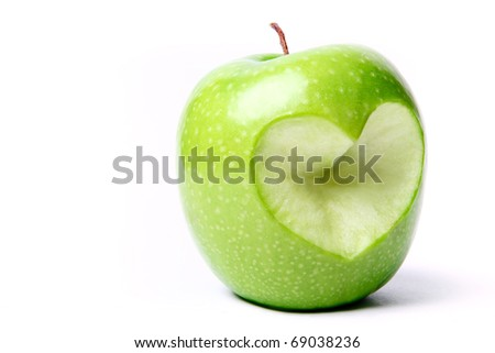 Green apple with cut off heart shape. - stock photo