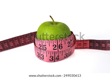 Green Apple with Measure Tape on White Background, Selective Focus   - stock photo