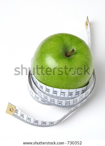 Green Apple with tape measure. - stock photo