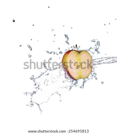 Green apple with water splash in spray of water - stock photo
