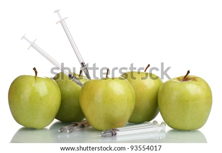 green apples and syringes isolated on white - stock photo