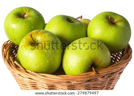 green apples in a wicker basket with drops isolated on white background - stock photo