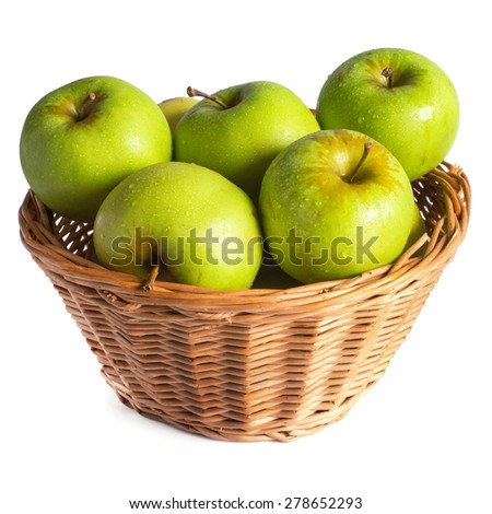 green apples in a wicker basket with drops isolated on white background (clipping patch included) - stock photo