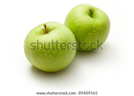 Green apples on the white background - stock photo