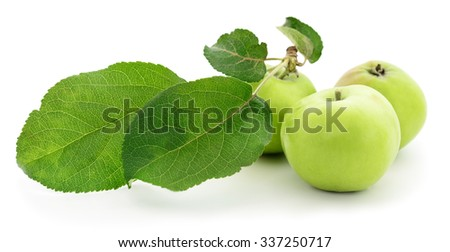 Green apples with leaves isolated on white.  - stock photo