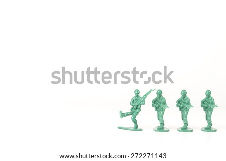 Green army leader steps off his foot stand and others follow - stock photo