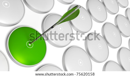 Green arrow hitting the center of a green  target with grey targets at the background - stock photo