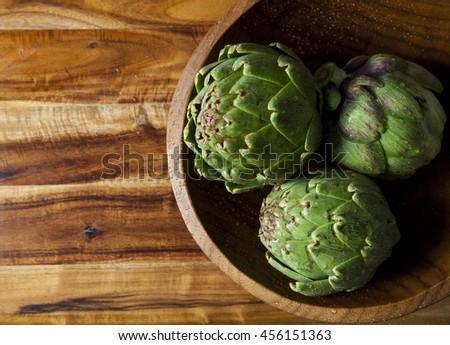 Green Artichoke Still Life - Kitchen, Culinary Art  - stock photo
