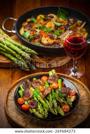 Green asparagus salad with roasted mushrooms and red wine - stock photo