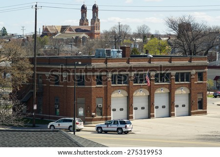 Green Bay, Wisconsin - April 27:  Green Bay Fire Station Headquarters in downtown Green Bay, view from Tilleman Bridge April 27, 2015.  - stock photo