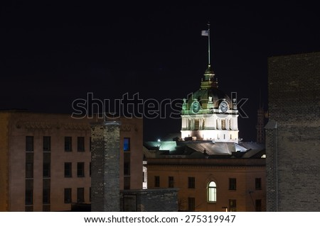 Green Bay, Wisconsin - March 9:  Downtown night view of the Brown County Courthouse taken from parking structure March 9, 2015 - stock photo