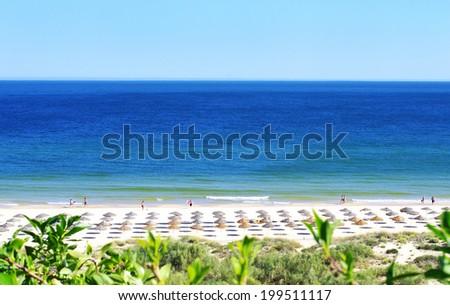 Green beach in Algarve, Portugal - stock photo