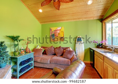 Green beach pool living room in the little house with sink and sofa. - stock photo
