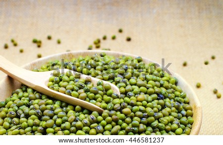 Green bean or mung bean in bowl and sack background. - stock photo