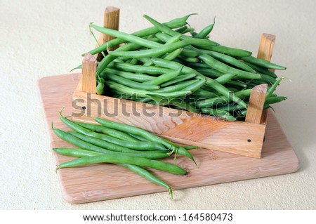 green bean with crate on cutting board - stock photo