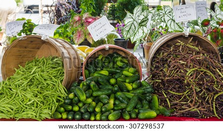 Green Beans, Cucumbers and October Beans at a Farmer's Market - stock photo