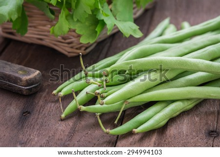 Green beans on wooden table  - stock photo