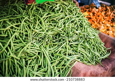 Green beans pods at the local french farmers market - stock photo