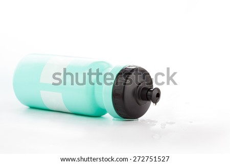 Green Bicycle water bottle with water drops isolated on white - stock photo