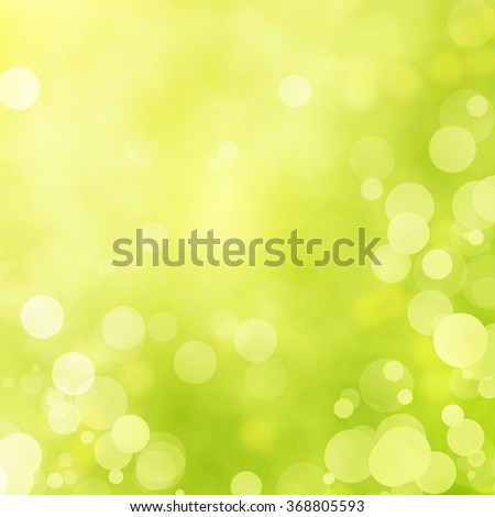 Green bokeh background. Natural spring and summer bokeh background. Yellow and green background. Sunbeam illuminates the background. - stock photo
