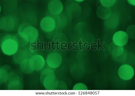 Green bokeh on a dark background - stock photo