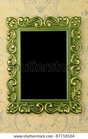 Green border with a pattern on the wall with the old wallpaper. - stock photo