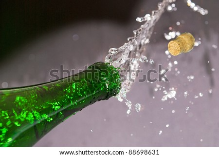 green bottle and cork flying - stock photo
