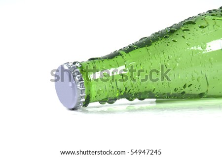 Green bottle with liquid - stock photo