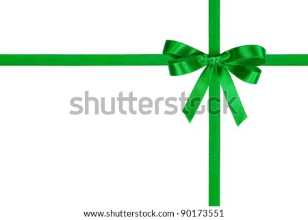 Green bow and crossed ribbons isolated on white. - stock photo
