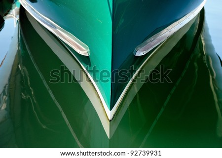 Green bow of a Maine Lobster boat docked in Coastal Maine - stock photo