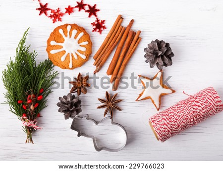 Green branches, spices, cones and gingerbread. Christmas still life. Up view. - stock photo