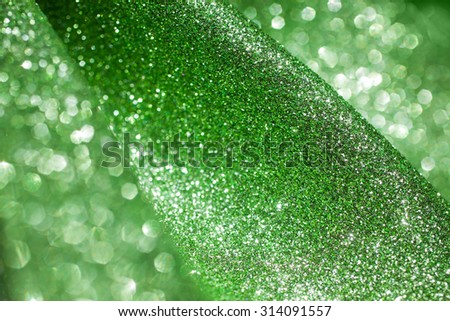 Green bright blur glitter texture. Green defocused abstract bokeh background. - stock photo