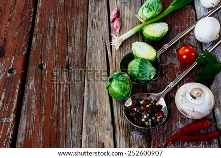 Green Bruxelles sprouts and mushrooms on a Wooden Background. Vegetarian food, health or cooking concept. Copyspace. - stock photo
