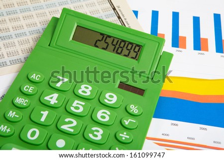 Green calculator and diagram on a business background - stock photo