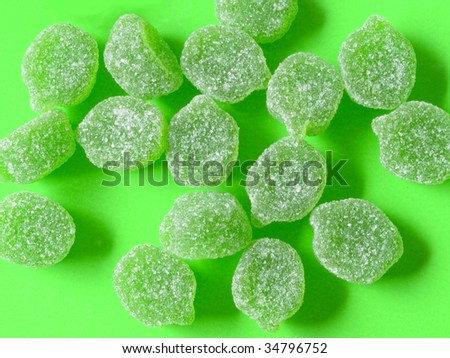 green candies on green background with green shadows - stock photo