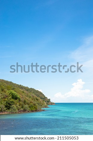 Green cape and blue sea in summer  - stock photo