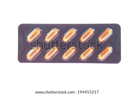Green capsule in brown blister pack - stock photo