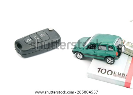 Green car, euro banknotes and black car keys on white - stock photo