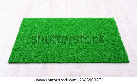 Green carpet on floor close-up - stock photo