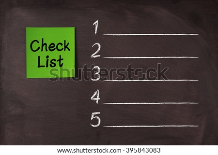 Green Check List sticky note pasted on blackboard. - stock photo