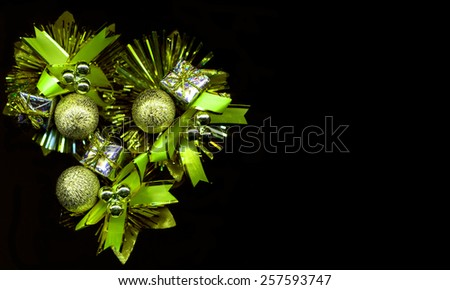 Green Christmas decoration on a black background - stock photo