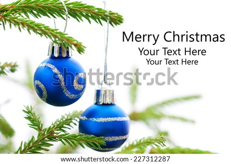 Green Christmas Fir Tree With Two Blue Christmas Balls Whith Silver Decoration On It And Your Text Here, White Background, Merry Christmas - stock photo