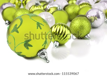 Green christmas ornament baubles on white - stock photo
