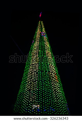 green Christmas tree lights on black background Night scene New Year Boke Lights Xmas Christmas Tree And Festive Illumination. Defocused Blue Bokeh  Effect. Design Backdrop. - stock photo