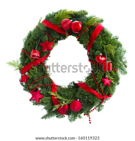 green christmas wreath with red decorations isolated on white background - stock photo