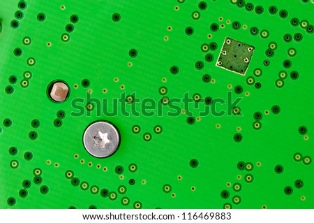 Green circuit board And nut - stock photo
