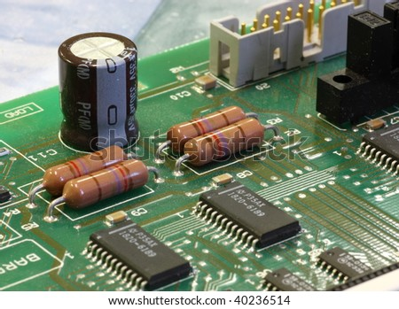 green circuit board with components - stock photo